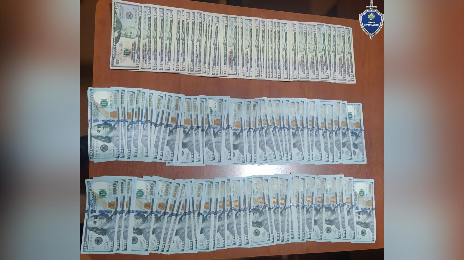 В Ферганской области трое мужчин пытались продать почти 25 тысяч фальшивых долларов